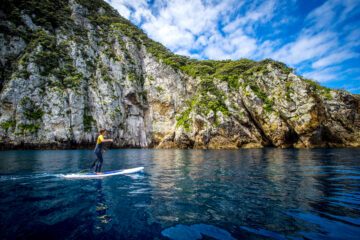 Paddleboarder at Poor Knights Islands